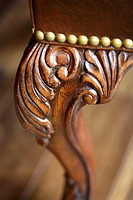 Ornate wood carving detail of leg of chair