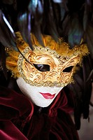 Venetian carnival mask display in a specialist shop near Rialto, San Polo, Venice, Veneto, Italy