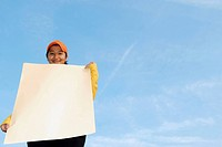 Woman holding a blank poster _ advertisement sign.