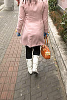 Young woman in trendy white boots. Shanghai. China