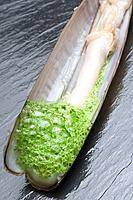 Razor shell with parsley and garlic foam at restaurant El Mercadito by Gonzalo Rey, Santiago de Compostela. La Coruña province, Galicia, Spain