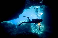 scuba diver diving in cave