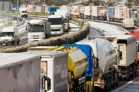 Trucks withheld because of the snow and ice on the highway A-6 in Galicia