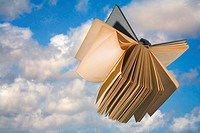 Book flying in the clouds, Paper flying in the clouds
