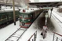 Woman on platform of Vladivostok railway station during winter in Russian Far East