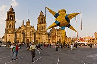 Cathedral with traditional Mexican pi–ata hanging in Mexico City´s Zocalo during Christmas