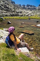 Cinco Lagunas Valley  Garganta del Pinar  Woman practice mountaineering in the mountains of the Sierra de Gredos National Park  Zapardiel de la Ribera...