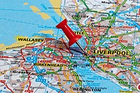 red map pin in road map pointing to city of Liverpool