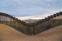 United States border fence, US/Mexico border, east of Nogales, Arizona, USA, looking south from US side of border