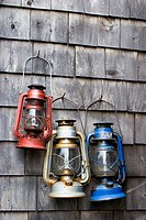 Lanterns hanging on a wall in Rockport, MA