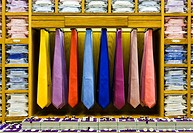 Colourful ties, shirts and cufflinks on display in a retail store