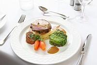 Roast beef dinner with gravy and vegetables