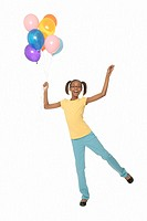 Ten year old girl holding balloons