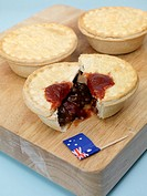 Australian meat pies on a chopping board