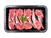 Supermarket packaged lamb chops isolated against a white background