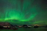 Northern lights shine above mountain peaks of Lofoten Islands, Looking north from Stamsund, Vestvågøy, Norway