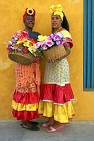 Two Cuban women in traditional dress, Plaza de la Catedral, Habana, Cuba
