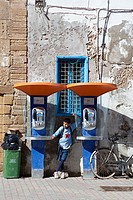 Morocco Essaouira Medina with two public phone boxes