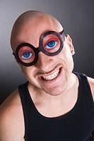 Bald man wearing funny glasses, smiling, portrait