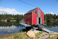 red fish shack on water near world heritage city of Lunenburg, Mahone Bay, Nova Scotia, Canada, North America.