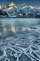 Dawn lights up Mt Sefton, reflection in frozen Mueller glacial lake, Aoraki / Mt Cook National Park.