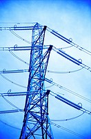Electricity tower against the sky toned blue