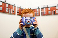 Boy taking a picture. The New Art Gallery Walsall, West Midlands, England