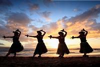 Silhouette of hula dancers at sunset at Palauea Beach, Maui, Hawaii