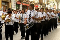 Musicians marching through the streets of Llanes, Llanes, Asturias