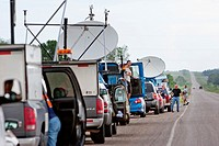 Storm chasers with Project Vortex 2 line up along a road in South Dakota, USA, June 3, 2010