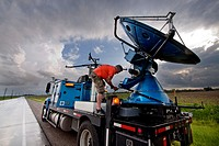 Doppler on Wheels driver Herb Stein ties down the radar dish near Des Moines, Iowa, June 5, 2010, after a storm chase  Herb and the DOW are participat...
