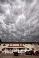 Mammatus clouds roll overhead an apartment complex in Kearney, Nebraska, June 7, 2010