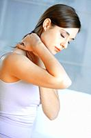 young brunette woman with neck pain