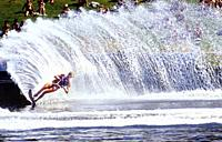 Water skier turning creating huge spray trail