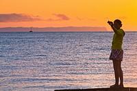 A sunset reveals the island of Niihau in background, images along the open coastal region of Waimea and the western side of Kauai, Hawaii, USA
