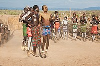 Karo people with body paintings participating in a tribal dance ceremony, Omo river Valley, Southern Ethiopia