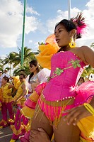 MEXICAN GIRLS WEARING CARNIVAL CLOTHES DANCING AND PARTICIPATING AT ISLA MUJERES MEXICAN LOCAL CARNIVAL, ISLA MUJERES, MEXICO, CENTRAL AMERICA