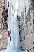 Man ice climbing a route called The Boy Scout which is rated WI,4 and located in Lamoille Canyon at The Ruby Mountains in northeastern Nevada