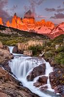 FitzRoy waterfall at dawn under famous rock peak Cerro FitzRoy  El Chalten , Parque Nacional Los Glaciares, Patagonia, Argentina.