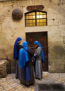 Nuns praying at the Seventh Stations on the Via Dolorosa, Via Dolorosa, Way of Sorrows, Stations of the Cross, Old City, Jerusalem, Israel.