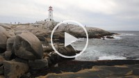Bagpipes being played and a view of the surf and lighthouse at Peggy´s Cove Nova Scotia Canada