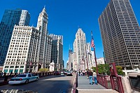 View along N Michigan Ave Bridge showing the Tribune Tower and Wrigley Building in Chicago, IL, USA