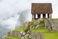 ´Watchman´s Hut´ or ´Guard House´ on a foggy morning at Machu Picchu, Peru