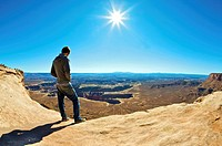 Young man Overlooking Colorado River Canyon in Canyonlands National Park  Grand View Point in Island in the Sky District  Near Moab, Utah