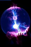 Children´s hands on a Plasma Globe