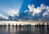 Dramatic clouds and sunbeams over a blue sky