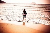 Girl in Laga beach, Biscay, Spain