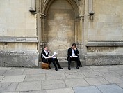 Students in Oxford dressed in morning suits with carnations in the button holes