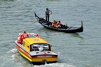 Gondola and ambulance boat, Grand Canal, Rialto bridge area, Venice, Veneto, Italy