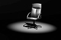 Leather office executive chair in spotlight 3D